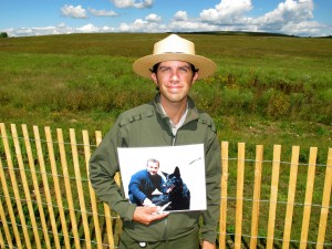 Brendan Wilson (holding a photo of Richard Guadagno) tells the stories of Flight 93 passengers' ties to nature in one of his interpretive talks